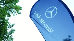 Symbol of Mercedes Benz on promotion flag  Stock Footage