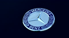 Symbol of Mercedes Benz on car - detail Stock Footage