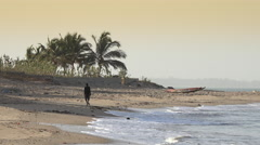 Black woman walking in a African beach - Africa landscape Stock Footage