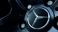 Symbol of Mercedes Benz on wheel - detail Stock Footage