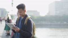4K Portrait of casual young man using computer tablet Stock Footage