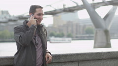 4K Portrait of casual young man making a phone call Stock Footage