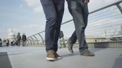 4K Low angle view of feet walking across a London bridge Stock Footage