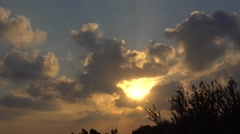 Strong sunrays through the clouds 4k (time lapse) Stock Footage