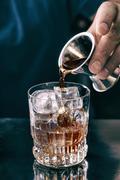 Barman making cocktail in bar Kuvituskuvat