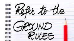 Refer To The Ground Rules written on notebook page Stock Photos