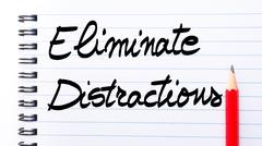 Eliminate Distractions written on notebook page Stock Photos