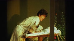 1969: a lady placing a white dog on a grooming table RENO, NEVADA Stock Footage