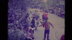 1974: parade scene with goofy from disney and alice in wonderland with rabbit Stock Footage