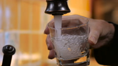 Close up of person filling a glass with clean drinking water in slow motion Stock Footage