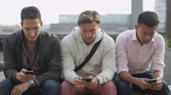 4K Group of casual male friends using mobile Stock Footage