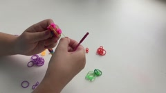 The making bracelets from rubber bands Stock Footage