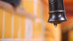Close up of a leaky faucet dripping and wasting water- ROOM FOR TEXT Stock Footage
