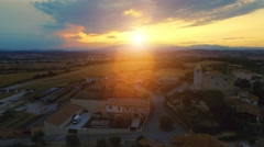 Aerial shot of a small old village / town in spain on a sunset with cloudy sky Stock Footage
