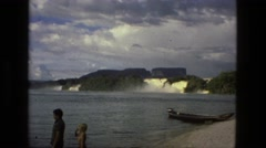 1979: people relaxing on water bank and in boats BRAZIL Stock Footage