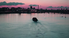 Ship Floats on The River at Night And Sky of Red Color Stock Footage