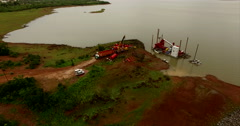 Aerial video. Gold mining in Mali, Africa, on a lake. N Stock Footage