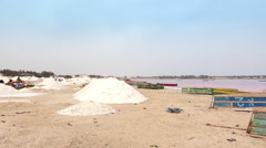 Salt piles in the pink lake - Lake Retba, Dakar region, Senegal, Afr Stock Footage