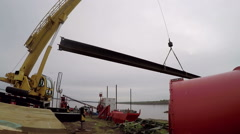 A crane lifts a huge metal beam. Stock Footage