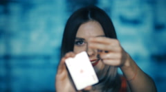 Pretty girl shows his cards - poker game Stock Footage