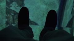 Shark and stingray under glass floor in oceanarium Stock Footage
