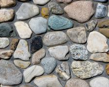 River rock stone wall with mortar joints Stock Photos