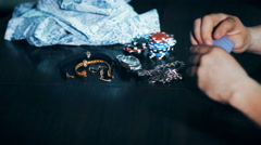 Girl lost in poker - takes off her clothes Stock Footage