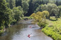 Man and woman in kayak at river Ourthe near La Roche-en-Ardenne, Belgium Stock Photos