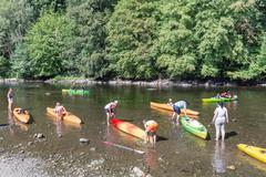 People with kayaks on the river Semois near Bouillon, Belgium Stock Photos