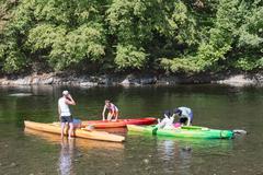 People with kayaks on the river Semois near Bouillon, Belgium Stock Photos