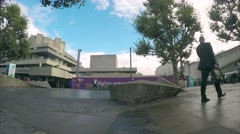 Time-lapse tourists walk past the National Theatre on the Thames Southbank Stock Footage