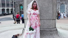 Bloodied zombie bride getting confused - scary Stock Footage
