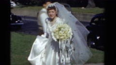 1943: bride in white satin BRIDGEPORT, CONNECTICUT Stock Footage