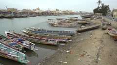 Dirty and poor african cityscape Fishing boats in the Senegal river, Saint Louis Stock Footage