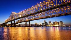 New Orleans City Skyline  & Crescent City Connection Bridge at Night Stock Photos