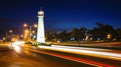 Biloxi Lighthouse at Night and Traffic in The Gulf Coast State of Mississippi Stock Photos