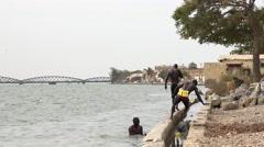 African black men swimming in the Senegal river - Saint Louis, Africa Stock Footage