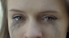 View of female, smudge eyes after crying looking to the camera Stock Footage