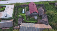 Aerial footage Top view of house and farm buildings in village from drone Stock Footage