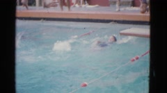 1953: this video is of the last lap of a women's backstroke swimming competition Stock Footage