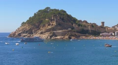 People at the beach in Tossa de Mar, Spain Stock Footage
