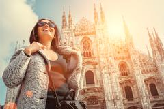 Smiling woman portrait near the Milan Cathedral Stock Photos