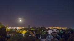 Moonset over the city Stock Footage
