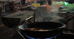 Cooking in street restaurant of Bangkok, Thailand Stock Footage
