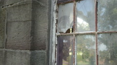 Broken rusted window on abandoned building Stock Footage