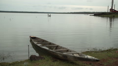 Fishermen on a lake in Mali, Africa. A beached boat on shore. Stock Footage