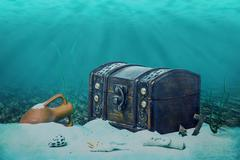 Beautiful opened empty old wooden treasure chest submerged underwater world w Stock Photos