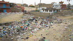 Poor African cityscape - plastic garbage heap on the street Stock Footage
