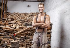 Shirtless lumberjack with an axe Stock Photos