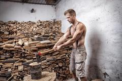 Shirtless lumberjack with an axe Stock Photos